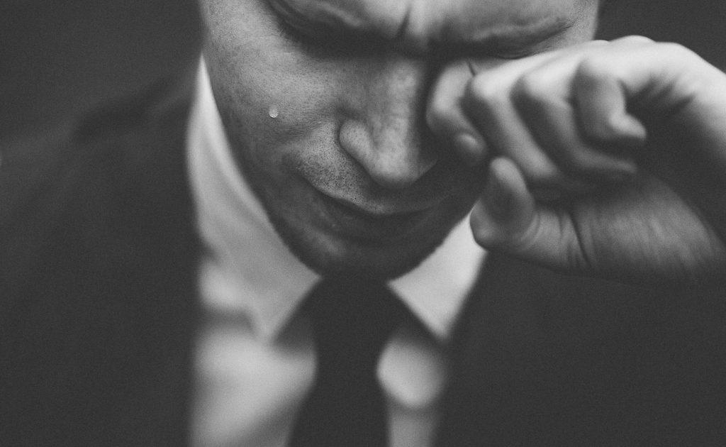 Failure - man in tears