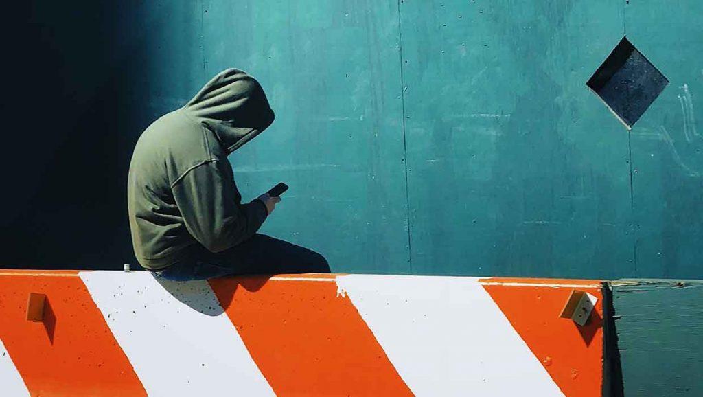 Cyberbullying_AloneWithHoodie